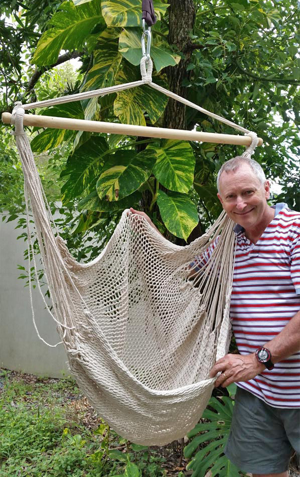 Medium image of white cotton rope hammock chair with man