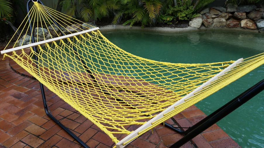 Medium image of yellow rope hammock with spreader bar angled